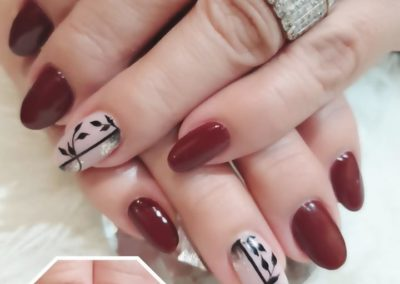 Solid Maroon Nails with Single Floral Nail