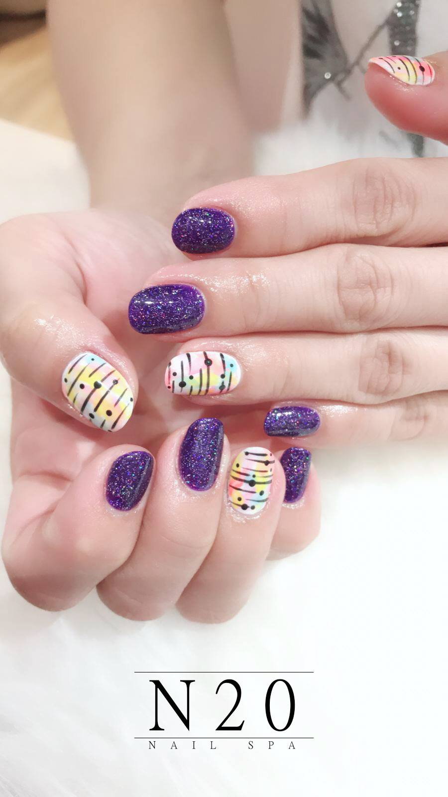 Glitters purple with pastel rainbows manicure nail art