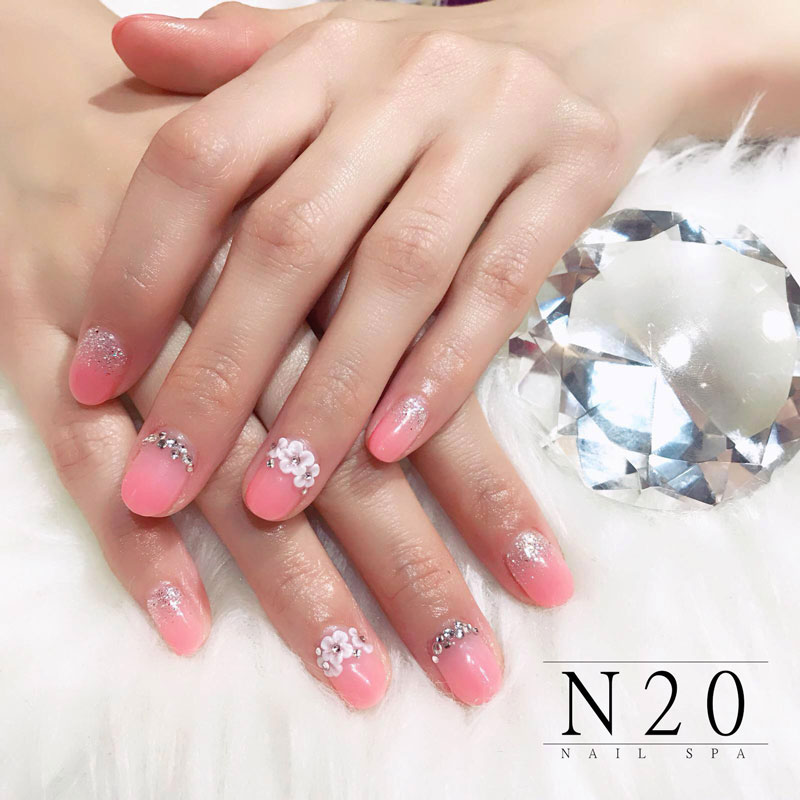 Pastel peach manicure with flowers and glitters set nail art