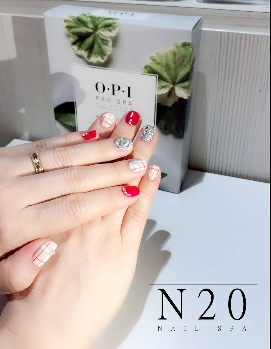 Haymarket Checks red shimmery silver studded manicure nail art