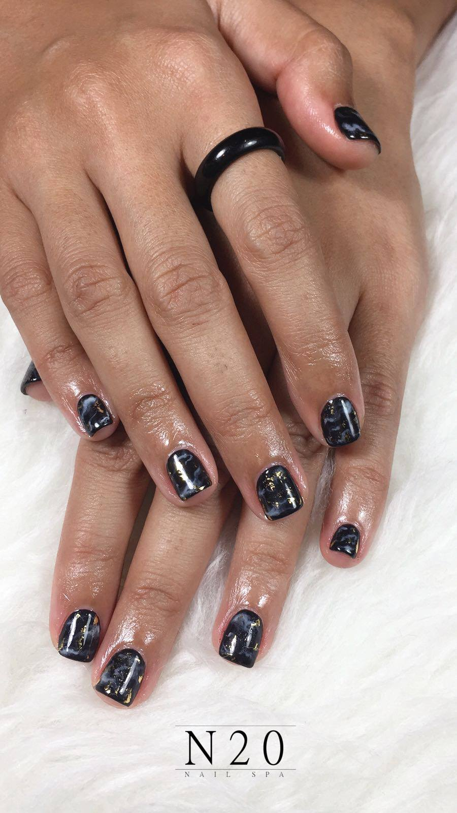 Black marble look manicure nail art with touch of gold - N20 Nail Spa