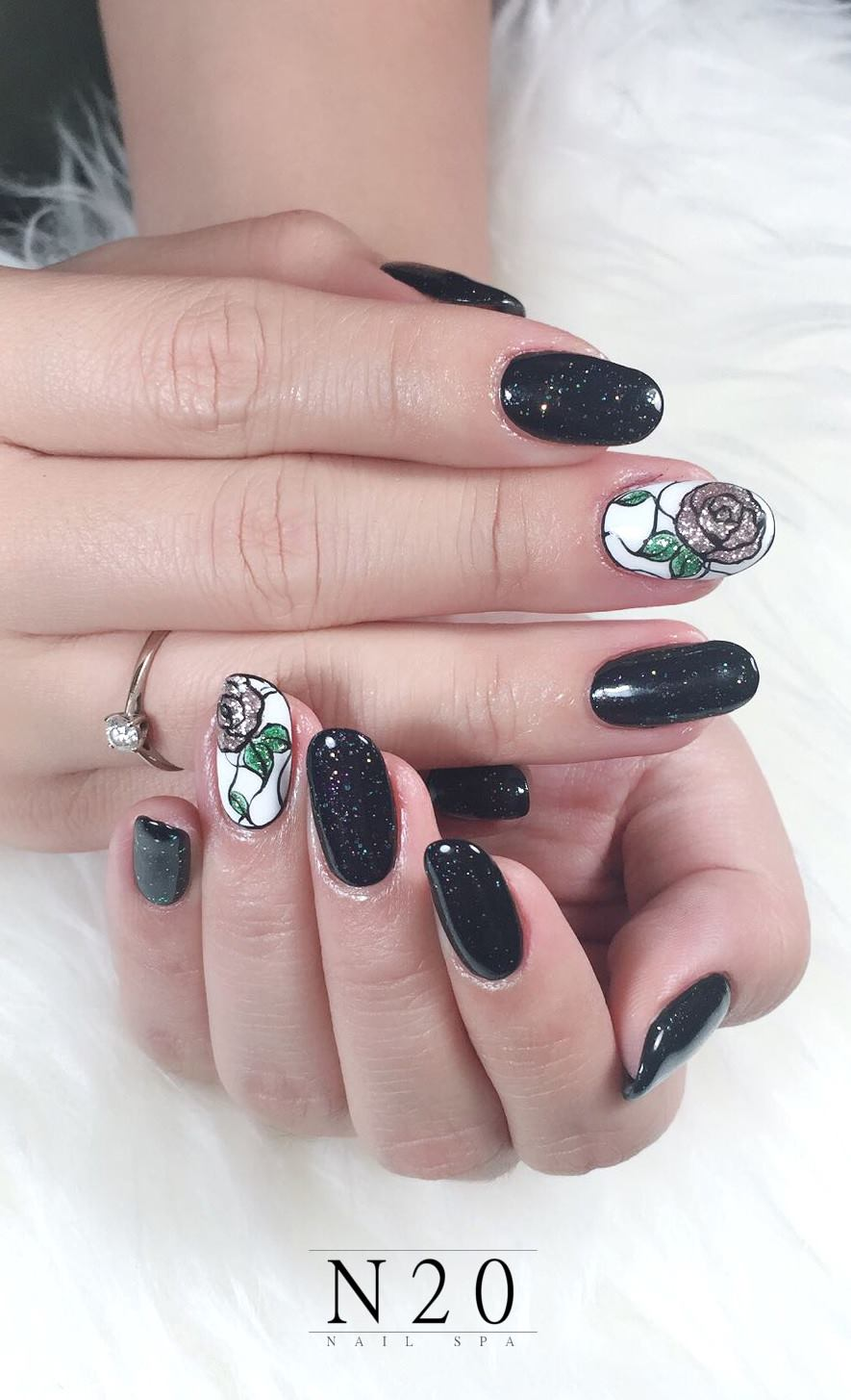 Glitter on bold black and flora on white manicure nail art - N20 Nail Spa
