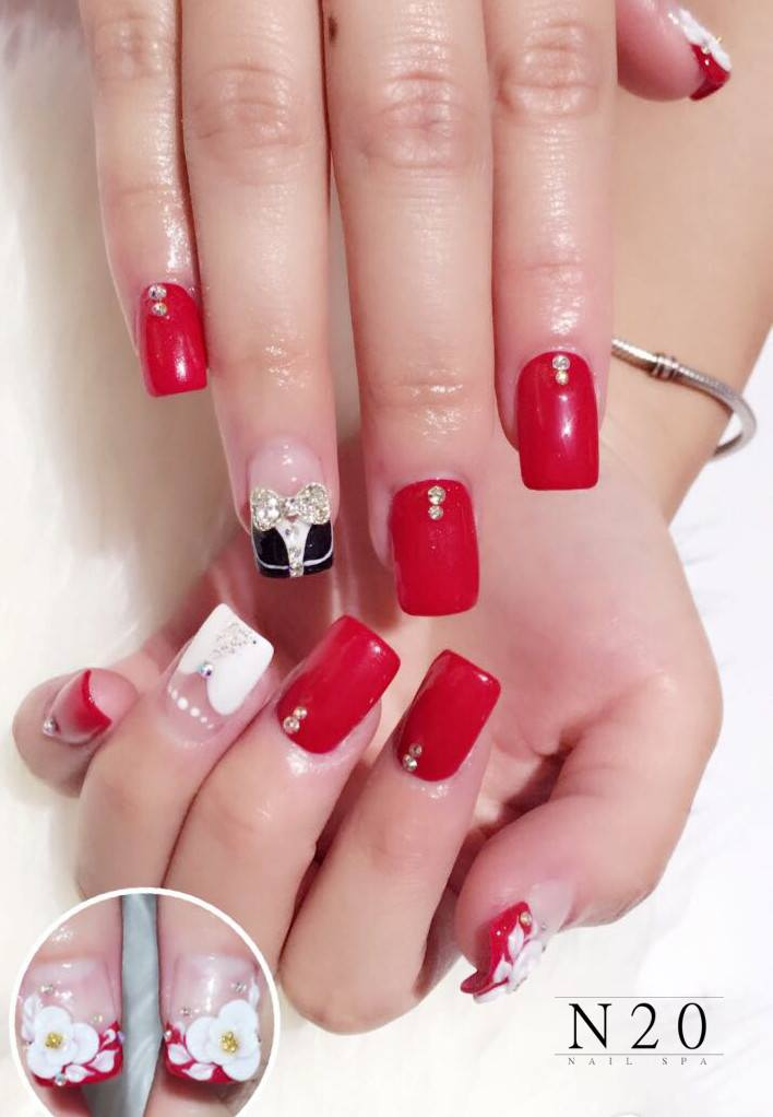 Red white manicure nail art with jewel flora - N20 Nail Spa